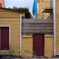 Yellow Buildings and Fence