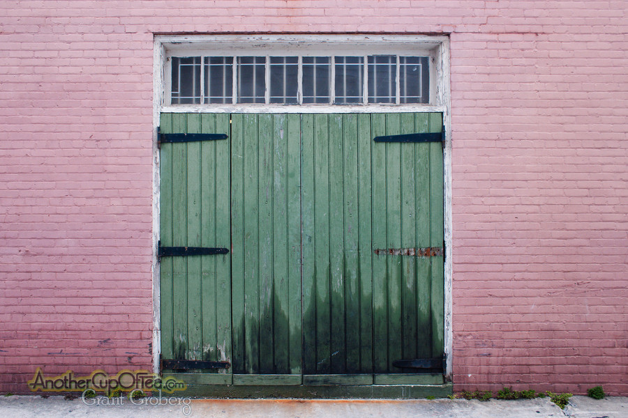 Wide Green Door in a Pink Wall