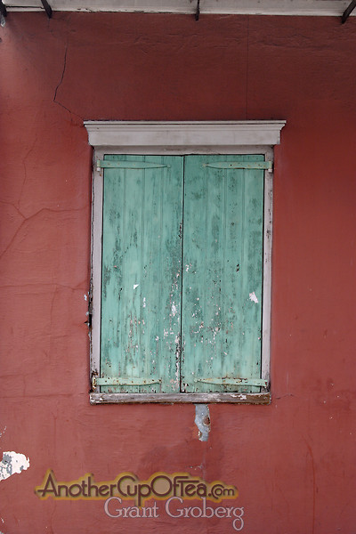 Green Shuttered Window Red Wall